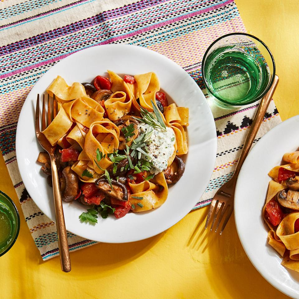 """<p>This mushroom ragout is topped with dollops of ricotta, which cut through the acidity of the tomato-based sauce for a balanced flavor and creamy texture.</p> <p> <a href=""""https://www.eatingwell.com/recipe/7896353/mushroom-ragout-with-herbed-ricotta-pappardelle/"""" rel=""""nofollow noopener"""" target=""""_blank"""" data-ylk=""""slk:View recipe"""" class=""""link rapid-noclick-resp""""> View recipe </a></p>"""