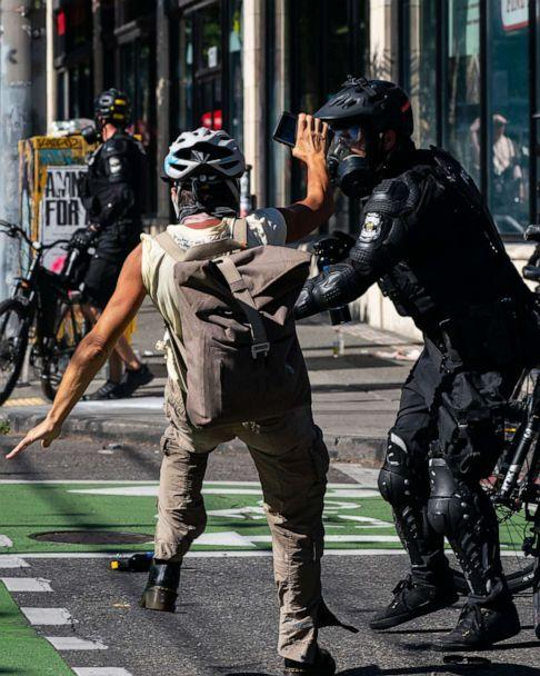 PHOTO: Police push a demonstrator to the ground during protests in Seattle, July 25, 2020. (David Ryder/Getty Images)