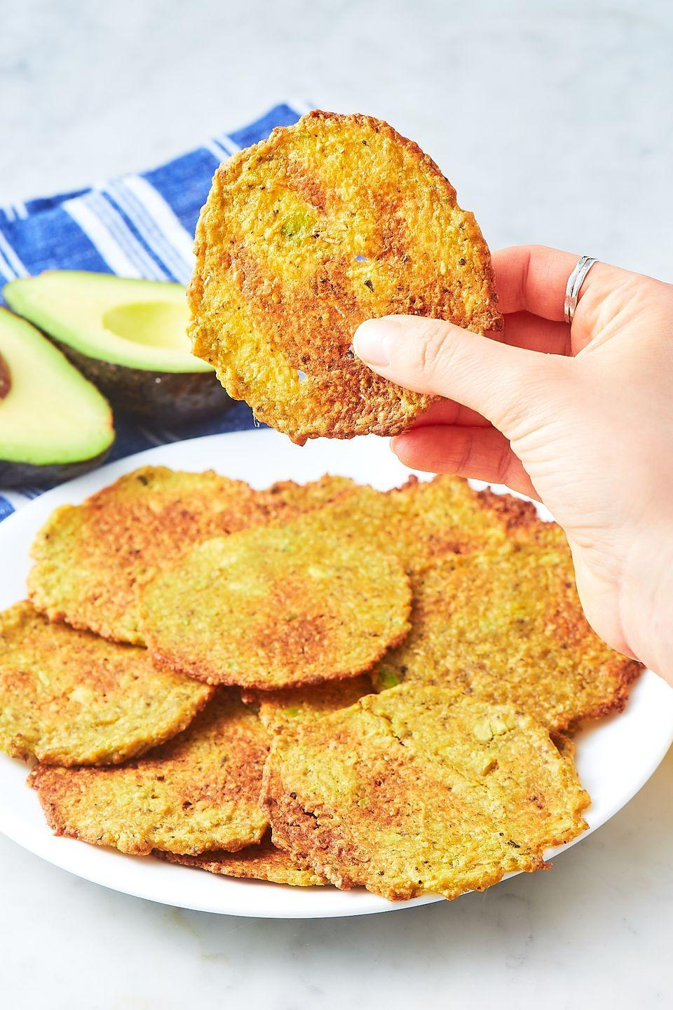 """<p>Keto fans, this one's for you.</p><p>Get the recipe from <a href=""""https://www.delish.com/cooking/recipe-ideas/a21948089/avocado-chips-recipe/"""" rel=""""nofollow noopener"""" target=""""_blank"""" data-ylk=""""slk:Delish"""" class=""""link rapid-noclick-resp"""">Delish</a>. </p>"""