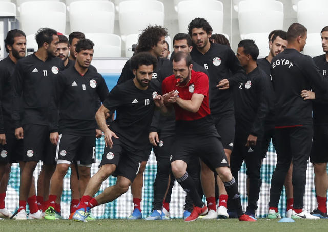 Egypt's Mohamed Salah, front left, warms up during Egypt's official training on the eve of the group A match between Saudi Arabia and Egypt at the 2018 soccer World Cup in the Volgograd Arena, in Volgograd, Russia, Sunday, June 24, 2018. (AP Photo/Darko Vojinovic)