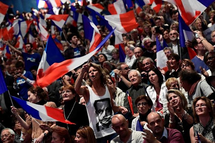 """Supporters cheer and wave France's national flag, as Nicolas Sarkozy casts himself as the champion of the suffering """"silent majority"""" against an """"elite for whom everything is fine"""" (AFP Photo/Miguel Medina)"""