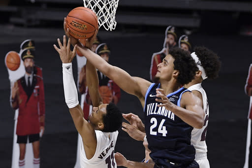 Villanova's Jeremiah Robinson-Earl, right, pulls down a rebound over Arizona State's Alonzo Verge Jr. in the second half of an NCAA college basketball game, Thursday, Nov. 26, 2020, in Uncasville, Conn. (AP Photo/Jessica Hill)