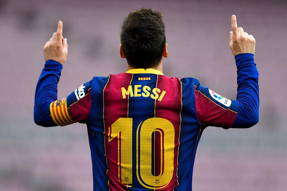 Barcelona's Argentine forward Lionel Messi celebrates after scoring a goal during the Spanish League football match between FC Barcelona  and RC Celta de Vigo at the Camp Nou stadium in Barcelona on May 16, 2021.