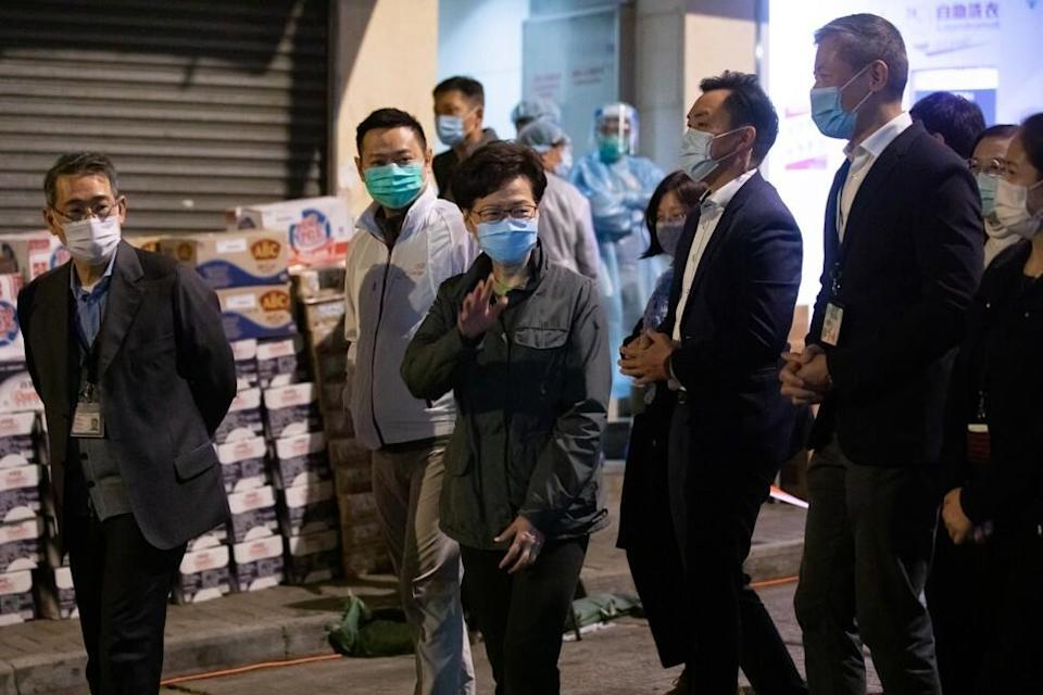 Carrie Lam visits the locked-down section of North Point. Photo: Bloomberg