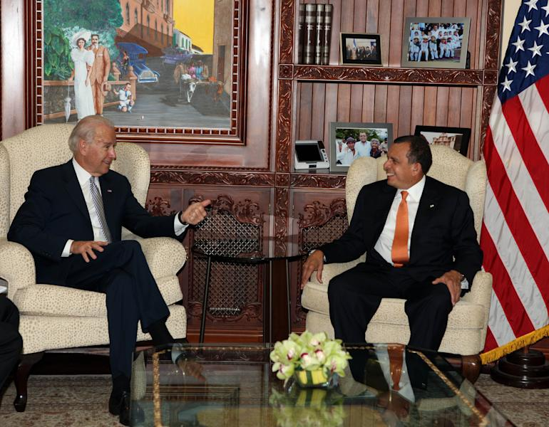 Vice President Joe Biden, left, talks with Honduras President Porfirio Lobo during a meeting at Presidential House in Tegucigalpa, Honduras, Tuesday March, 6, 2012. Biden is on a one-day official visit to Honduras. The vice president's two-day trip to Mexico and Honduras comes amid calls by many of the region's leaders to discuss decriminalizing drugs as a way to ease a vicious war on cartels that has left Latin America bloodied. (AP Photo/Wilfredo Valladares, Honduras Presidential House)