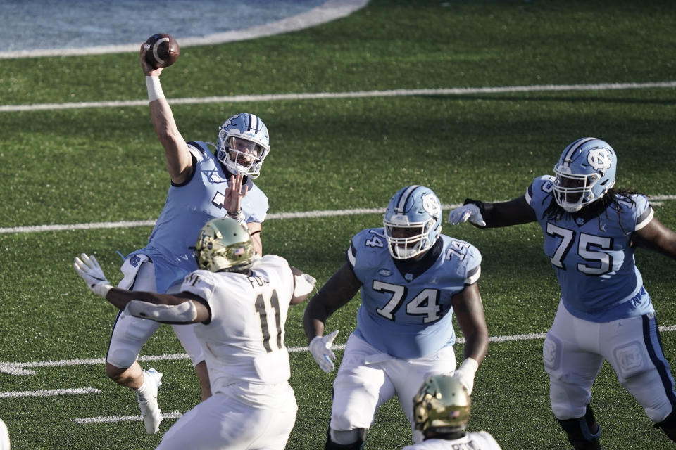 North Carolina quarterback Sam Howell (7) passes against Wake Forest during the second half of an NCAA college football game in Chapel Hill, N.C., Saturday, Nov. 14, 2020. (AP Photo/Gerry Broome)
