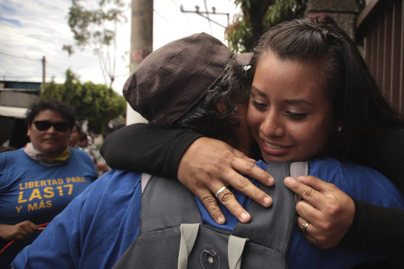 Evelyn Hernandez, 21, gets a hug after being acquitted on charges of aggravated homicide in her retrial related to the loss of a pregnancy in 2016, outside the court in Ciudad Delgado on the outskirts of San Salvador, El Salvador, Monday, Aug. 19, 2019. Hernandez, who has said she did not realize she was pregnant as the result of a rape when she gave birth into a latrine at 32 weeks, was originally sentenced to 30 years under El Salvador's strict abortion laws. (AP Photo/Salvador Melendez)
