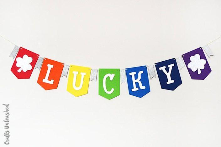 """<p>Make Paddy's Day a banner one with this cool craft that spells it all out. </p><p><strong>Get the tutorial at <a href=""""http://blog.consumercrafts.com/seasonal/spring/st-patricks-day-decorations/diy-lucky-banner/"""" rel=""""nofollow noopener"""" target=""""_blank"""" data-ylk=""""slk:Crafts Unleashed"""" class=""""link rapid-noclick-resp"""">Crafts Unleashed</a>.</strong></p><p><strong><a class=""""link rapid-noclick-resp"""" href=""""https://go.redirectingat.com?id=74968X1596630&url=https%3A%2F%2Fwww.walmart.com%2Fsearch%2F%3Fquery%3Dgreen%2Band%2Bwhite%2Bbakers%2Btwine&sref=https%3A%2F%2Fwww.thepioneerwoman.com%2Fhome-lifestyle%2Fcrafts-diy%2Fg34931626%2Fst-patricks-day-decorations%2F"""" rel=""""nofollow noopener"""" target=""""_blank"""" data-ylk=""""slk:SHOP GREEN AND WHITE BAKER'S TWINE"""">SHOP GREEN AND WHITE BAKER'S TWINE</a><br></strong></p>"""