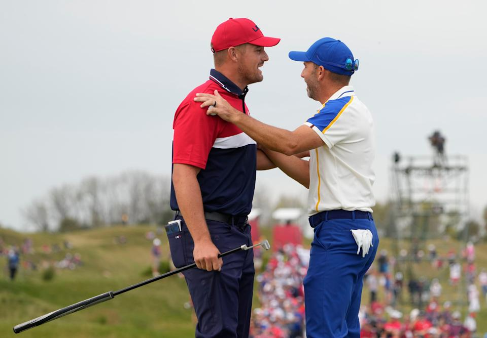 Bryson DeChambeau and Sergio Garcia on the 15th green during day three singles rounds at the Ryder Cup.