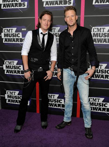 Tyler Hubbard, left, and Brian Kelley, of the group Florida Georgia Line, arrive at the 2013 CMT Music Awards at Bridgestone Arena on Wednesday, June 5, 2013, in Nashville, Tenn. (Photo by Frank Micelotta/Invision/AP)