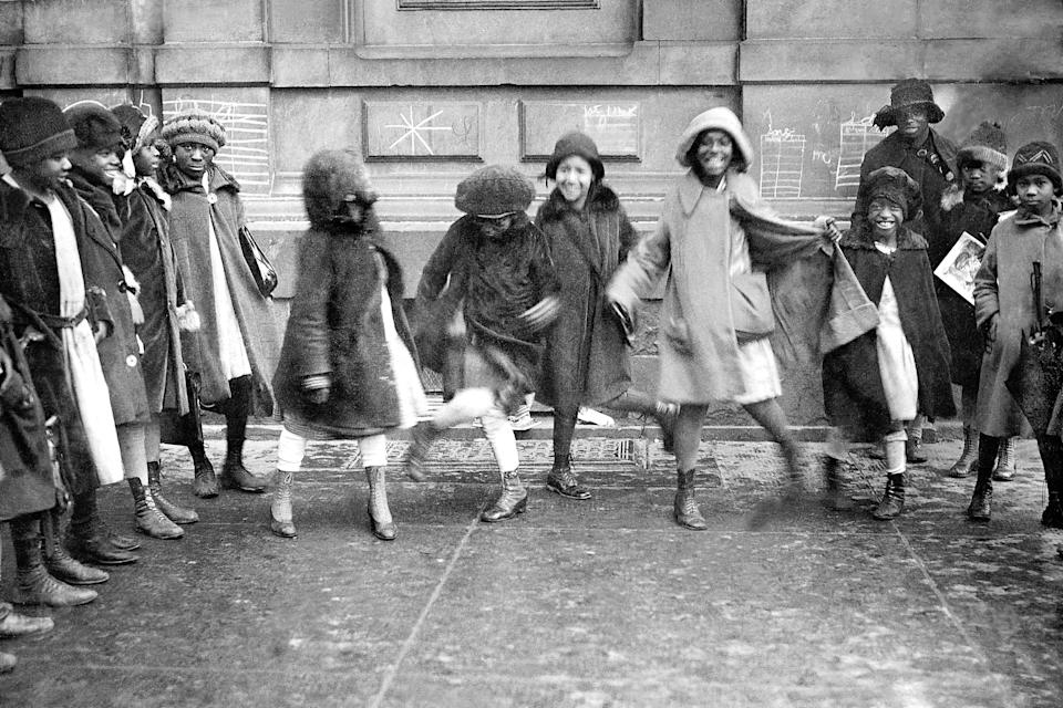 Young girls dancing the Charleston in Harlem. Although the dance existed prior to the 1920s, it shot to popularity after appearing in the Broadway show <em>Running Wild</em> in 1923.
