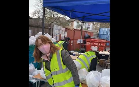 Kay Burley handing out food packages in North West London. (London's Community Kitchen/Facebook)