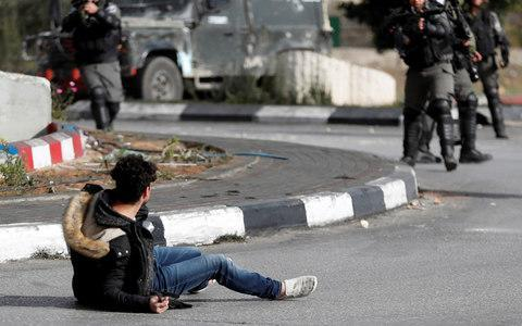 <span>Mohammed Aqal, 29, stabbed a border police officer at a checkpoint in the occupied West Bank while wearing what appeared to be a suicide vest, before being shot three times by police</span> <span>Credit: GORAN TOMASEVIC/ REUTERS </span>