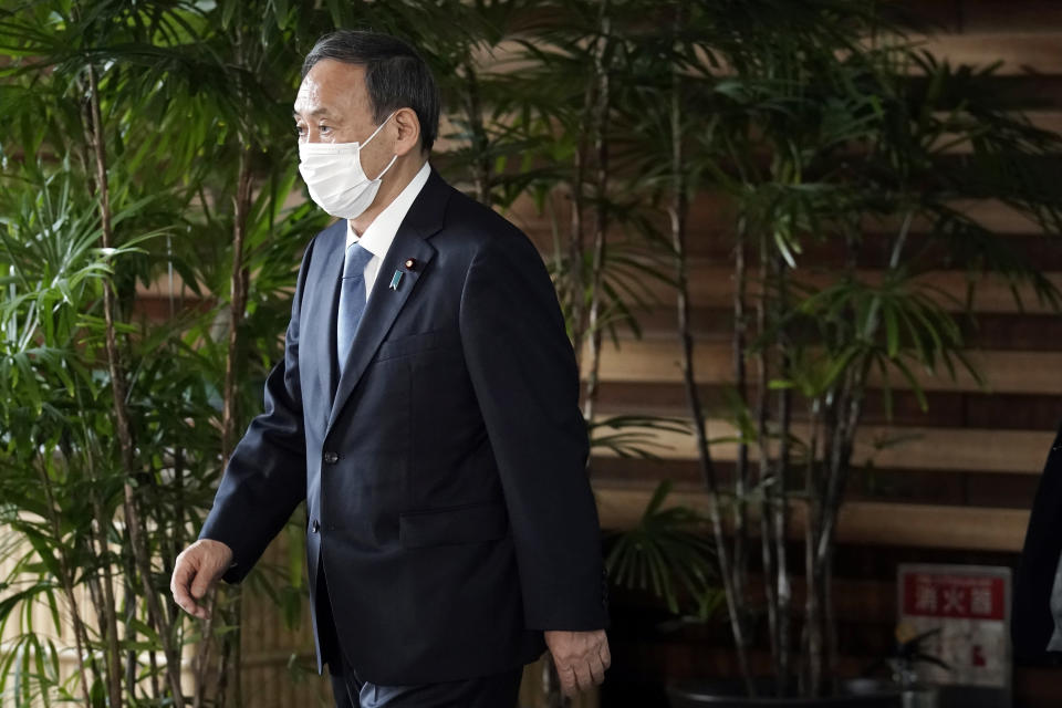 Former Chief Cabinet Secretary Yoshihide Suga walks out of the prime minister's office after a cabinet meeting Wednesday, Sept. 16, 2020, in Tokyo. Prime Minister Shinzo Abe and his Cabinet resigned, clearing the way for his successor Suga to take over after parliamentary confirmation later Wednesday. (AP Photo/Eugene Hoshiko)