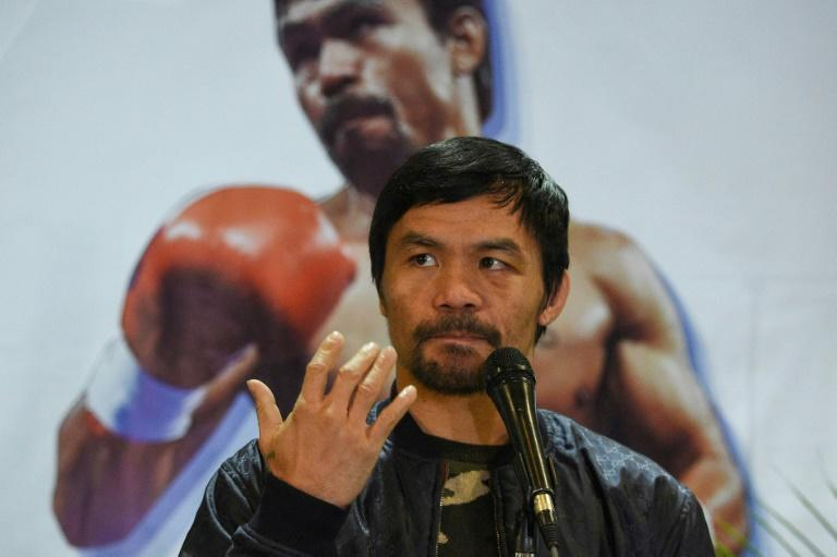 Philippine boxer-turned-politician Manny Pacquiao stepped into the ring for the country's 2022 presidential race (AFP/Ted ALJIBE)