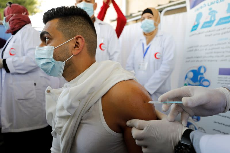 Palestinian health workers are vaccinated against COVID-19 in Bethlehem