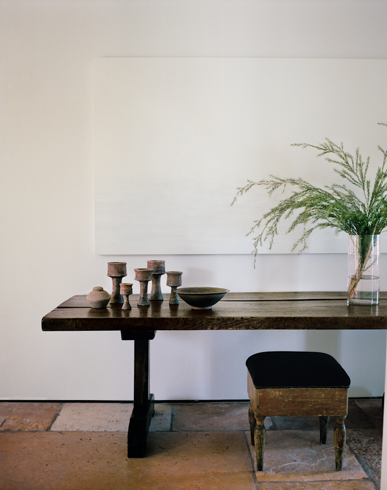"<p>Designer <a href=""https://www.kevinspearman.com/"">Kevin Spearman</a> devised little vignettes throughout the halls and rooms of this Tel Aviv estate to help energize the traditional architecture. In the hallway, a tonal white artwork by <a href=""http://marybeththielhelm.com/"" target=""_blank"">MaryBeth Thielhelm</a> hangs above an antique Scottish table.</p>"