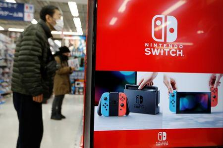 Logos of Nintendo Switch game console are seen at an electronics store in Tokyo