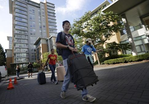 University students move in to campus accommodations at UBC in Vancouver in this 2015 file photo. Photo: Xinhua