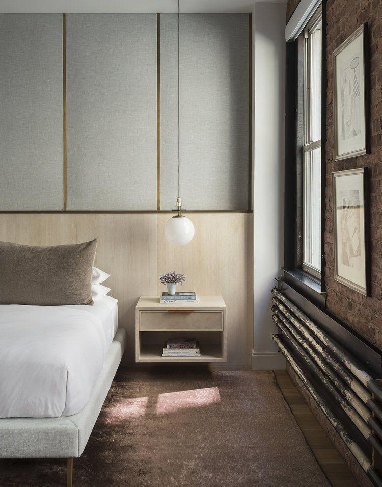 <p>Upholster your walls to set a soft, dreamy mood in the bedroom. Instead of the doing the entire wall, contrast the fabric with something like wood or concrete. </p>