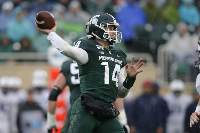 Michigan State quarterback Brian Lewerke throws a pass against Penn State during the second quarter of an NCAA college football game, Saturday, Oct. 26, 2019, in East Lansing, Mich. (AP Photo/Al Goldis)
