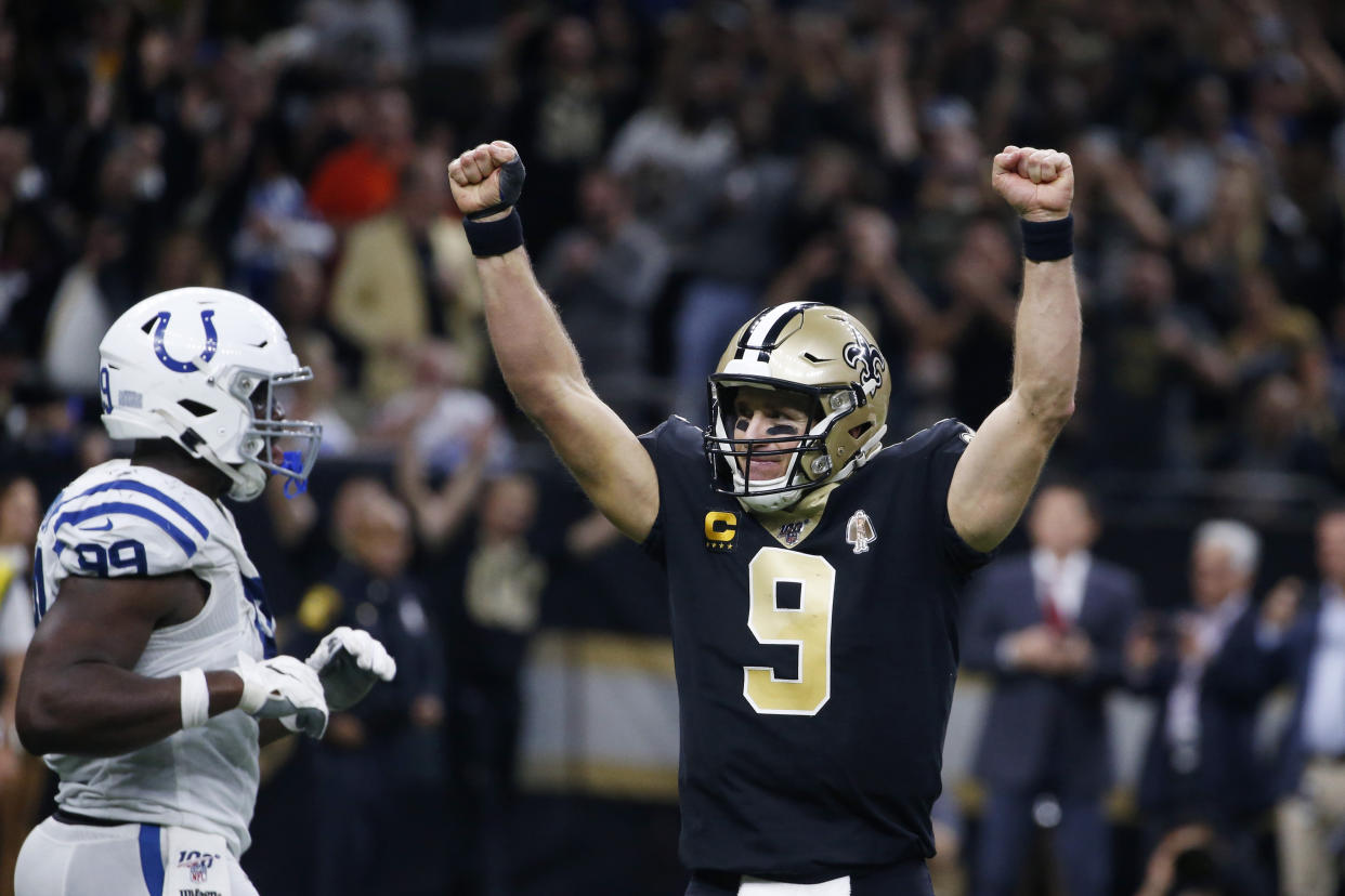 New Orleans Saints quarterback Drew Brees (9) celebrates his touchdown pass to tight end Josh Hill, which broke the NFL record for career touchdown passes, surpassing Peyton Manning. (AP Photo/Butch Dill)