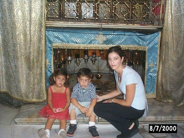 Des Moines Register journalist Andrea Sahouri photographed in Bethlehem with her brother, Alex Sahouri, and mother, Muna Tareh-Sahouri, during a childhood visit to Palestine.