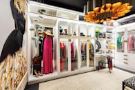 """<p>When <a href=""""https://nwdinteriors.com/"""" rel=""""nofollow noopener"""" target=""""_blank"""" data-ylk=""""slk:White"""" class=""""link rapid-noclick-resp"""">White</a> began creating this custom walk-in closet with the <a href=""""https://www.containerstore.com/welcome.htm"""" rel=""""nofollow noopener"""" target=""""_blank"""" data-ylk=""""slk:Container Store"""" class=""""link rapid-noclick-resp"""">Container Store</a>, her main goal was to showcase the clothing and accessories and to amplify Black creative voices. And from a stunning floor-to-ceiling print by<a href=""""https://kabriahasha.art/"""" rel=""""nofollow noopener"""" target=""""_blank"""" data-ylk=""""slk:Kabriah Asha"""" class=""""link rapid-noclick-resp""""> Kabriah Asha</a> to a hand-carved accent chair from <a href=""""https://www.jomofurniture.com/nyala-chair.html"""" rel=""""nofollow noopener"""" target=""""_blank"""" data-ylk=""""slk:Jomo Furniture"""" class=""""link rapid-noclick-resp"""">Jomo Furniture</a>, White brought her vision to life in the most fashionable way. <br><br><br><br><br><br></p>"""