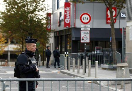 Police take up position near the Stade de France stadium the morning after a series of deadly attacks in Paris
