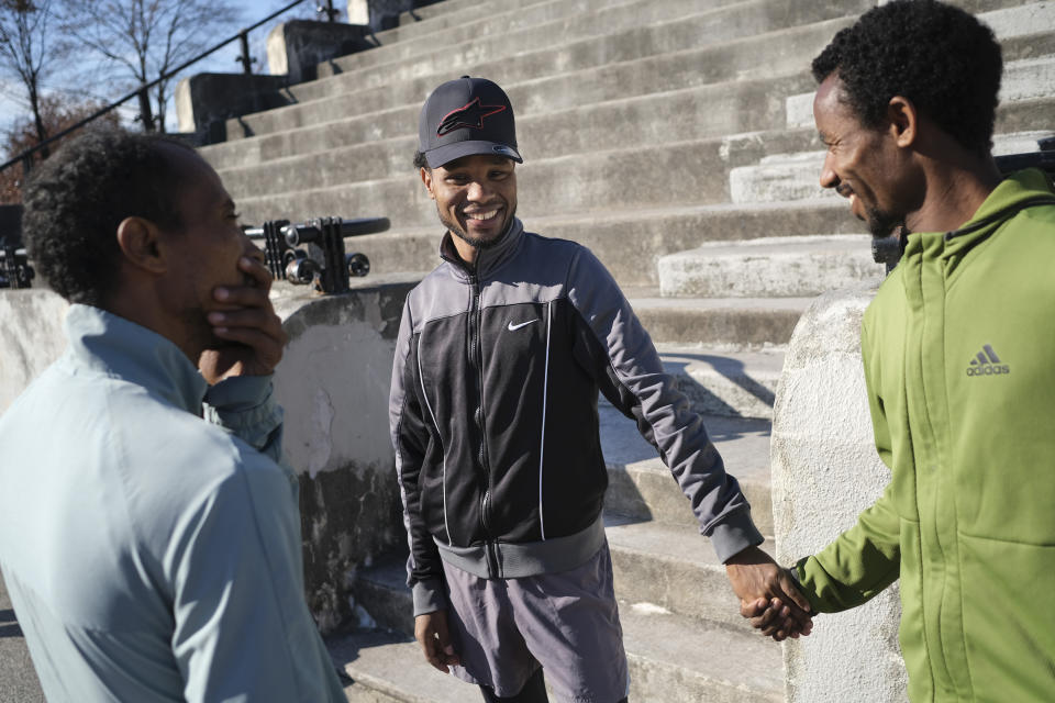Diriba Degefa Yigezua, center, greets other Ethiopian runners after a short workout at Van Cortlandt Park in the Bronx borough of New York, Tuesday, Nov. 26, 2019. Degefa Yigezua had won the Philadelphia Marathon the previous weekend. Girma Bekele Gebre stunned the elite field at the New York City Marathon by finishing third as a nonelite entrant in November. It was a life-changing performance for the Ethiopian runner, and one made possible because of his involvement with the West Side Runners' Club. Team President Bill Staab has spent four decades helping immigrant runners acquire visas and gain entry to U.S. races, spending nearly $1 million of his own money to cover fees. Bekele Gebre is his greatest success, but not nearly the only runner he's helped. (AP Photo/Seth Wenig)