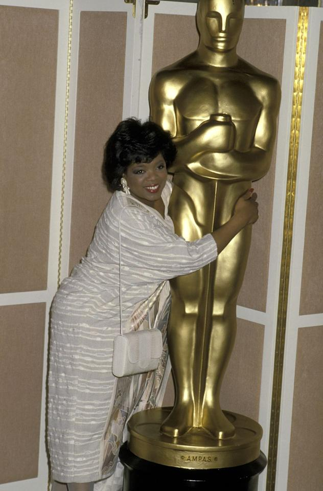 """<p>Oprah attended her first-ever Oscars at the 58th annual ceremony. She was nominated for Best Actress for her role in the Steven Spielberg-directed film <em><a href=""""https://www.oprahmag.com/entertainment/tv-movies/a25616715/the-color-purple-quotes-anniversary/"""" target=""""_blank"""">The Color Purple</a></em>.<em></em></p><p>In 2017, Gayle <a href=""""https://www.hollywoodreporter.com/news/gayle-king-reveals-why-oprah-didnt-want-win-at-1986-oscars-guest-column-978159"""" target=""""_blank"""">revealed to </a><em><a href=""""https://www.hollywoodreporter.com/news/gayle-king-reveals-why-oprah-didnt-want-win-at-1986-oscars-guest-column-978159"""" target=""""_blank"""">The Hollywood Reporter</a> </em>that Oprah didn't even want to win the award because of a wardrobe malfunction: Her dress was too small that night. """"She discovered that an hour before the show,"""" Gayle said. """"So she was sitting there thinking, 'Please don't call my name, please don't call my name, please don't call my name.' Because of her dress!""""<em></em><em></em></p>"""