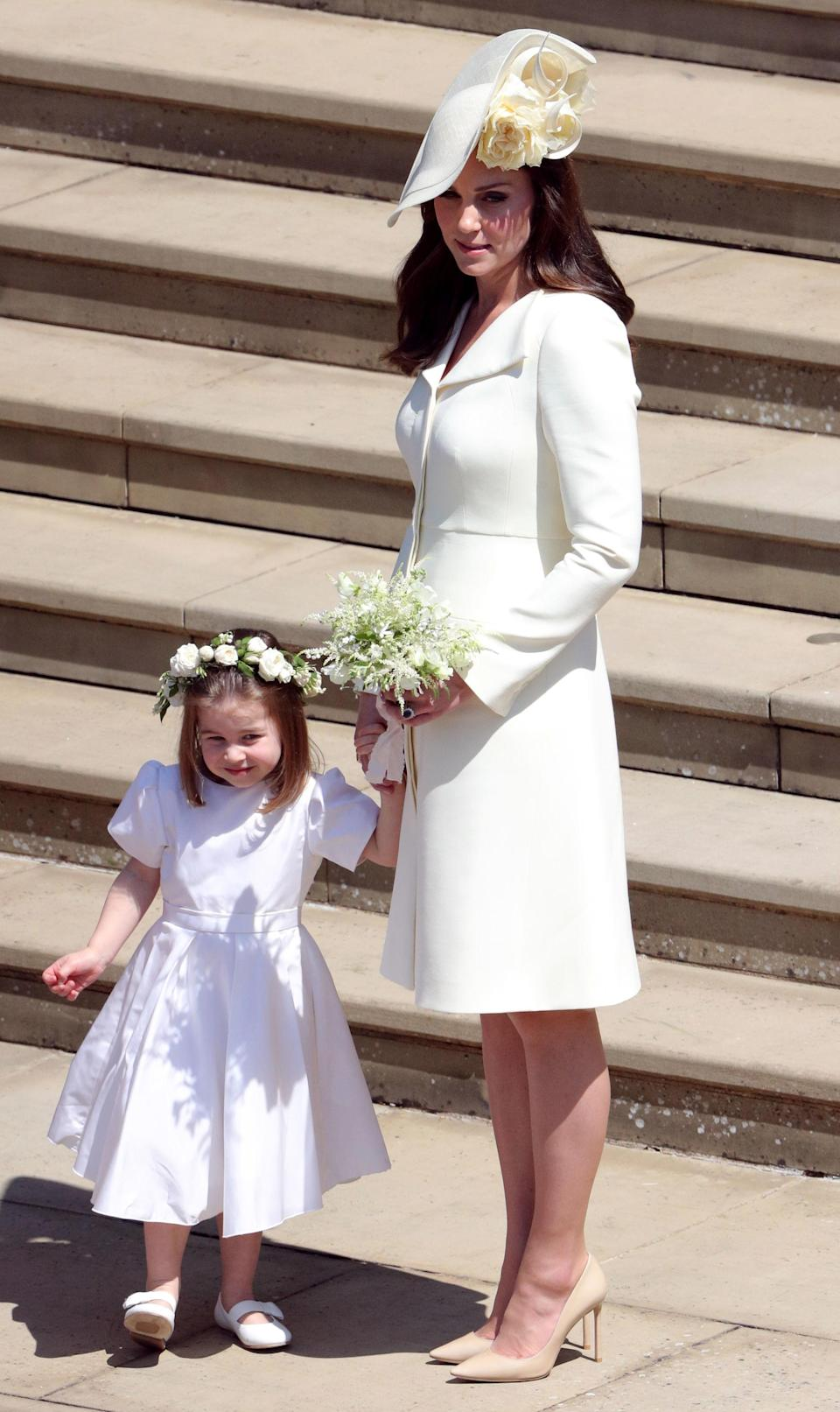 <p>For the Duke and Duchess of Sussex's royal nuptials, the Duchess of Cambridge wore a primrose yellow coat dress by Alexander McQueen. She first donned the look at Princess Charlotte's christening in white. <em>[Photo: Getty]</em> </p>