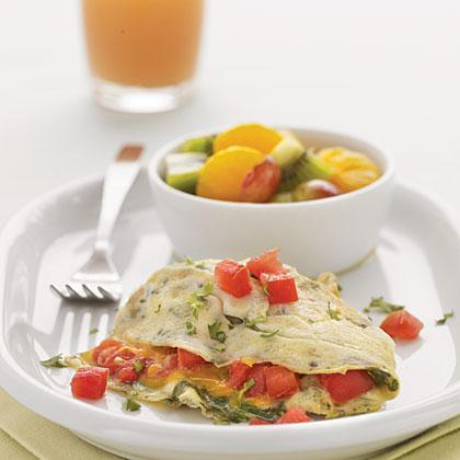 """<p>This veggie-packed omelet is perfect for brunch or a simple supper. For a delicious side, serve a medley of <a href=""""https://www.myrecipes.com/fruit-recipes"""" rel=""""nofollow noopener"""" target=""""_blank"""" data-ylk=""""slk:fresh fruit"""" class=""""link rapid-noclick-resp"""">fresh fruit</a>, such as Mandarin Oranges with Kiwifruit and Grapes.</p>"""
