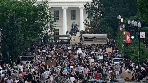 PHOTO: National Guard vehicles are used to block 16th Street near Lafayette Park and the White House as Demonstrators participate in a peaceful protest against police brutality and the death of George Floyd, on June 3, 2020, in Washington, DC. (Drew Angerer/Getty Images)