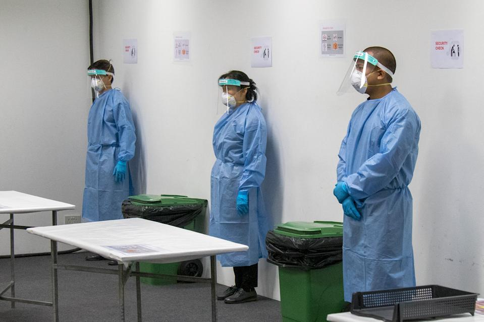 Staff at the Changi Exhibition Centre isolation facility for COVID-19 patients seen fully outfitted in personal protective equipment, during a media tour on 24 April 2020. (PHOTO: Dhany Osman / Yahoo News Singapore)