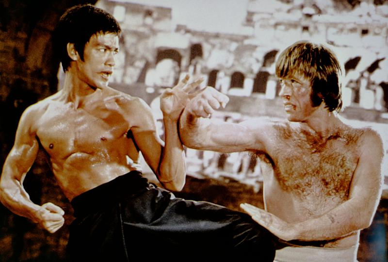 """American martial artist Chuck Norris with Chinese American martial artist, actor, director and screenwriter Bruce Lee on the set of his movie """"The Way of the Dragon."""" (Photo: Sunset Boulevard via Getty Images)"""
