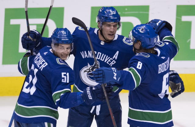 Vancouver Canucks right wing Brock Boeser (6) celebrates his goal against the Buffalo Sabres with teammates Troy Stecher (51) and Bo Horvat (53) during the second period of an NHL hockey game Friday, Jan. 18, 2019, in Vancouver, British Columbia. (Jonathan Hayward /The Canadian Press via AP)