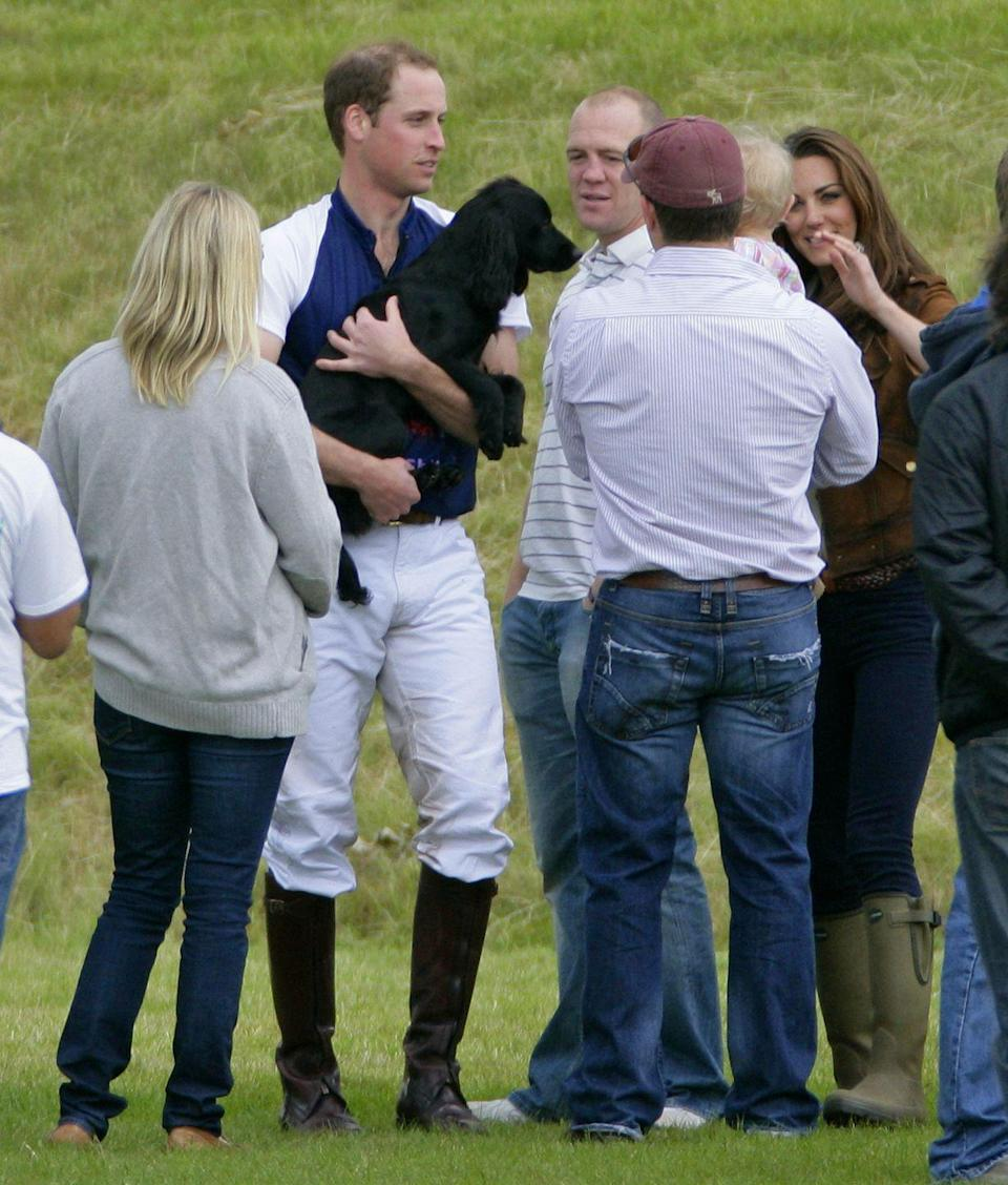 <p>Whether you're royal or not, one fact remains: Everyone loves their dog. Prince William showed that he has a soft spot for his family pup, Lupo, after picking her up for a cuddle post-polo match in 2012.</p>