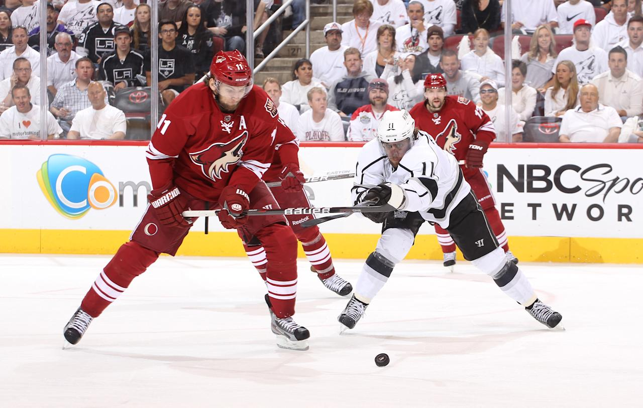 GLENDALE, AZ - MAY 15:  Anze Kopitar #11 of the Los Angeles Kings and Martin Hanzal #11 of the Phoenix Coyotes vie for the puck in the second period of Game Two of the Western Conference Final during the 2012 NHL Stanley Cup Playoffs at Jobing.com Arena on May 15, 2012 in Phoenix, Arizona.  (Photo by Christian Petersen/Getty Images)