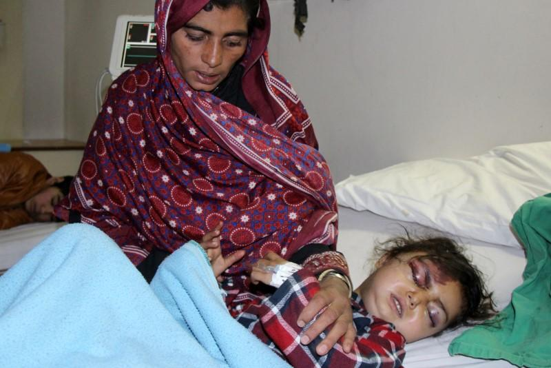 Six-year-old Safia bibi, who was rescued after heavy snowfall and avalanches receives medical treatment at a hospital in Muzaffarabad
