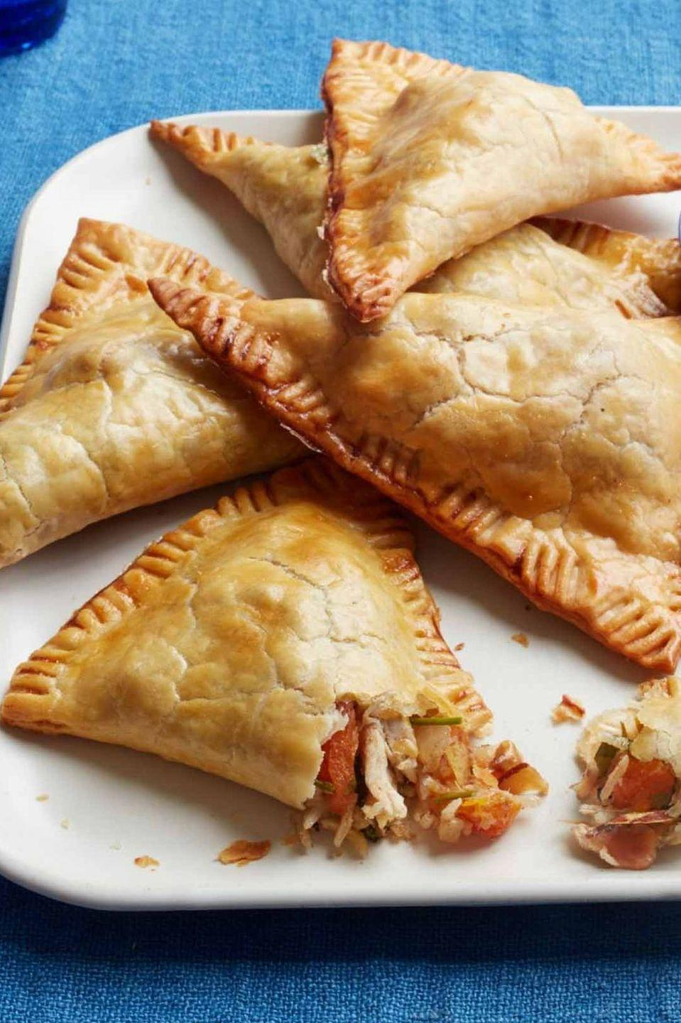 """<p>Turn a roasted bird into the perfect weekend movie snack by using it as the base for a sweet and spicy fruit mixture. </p><p><em><a href=""""https://www.womansday.com/food-recipes/food-drinks/recipes/a52072/turkey-turnovers-with-apricots-and-almonds/"""" rel=""""nofollow noopener"""" target=""""_blank"""" data-ylk=""""slk:Get the recipe from Woman's Day »"""" class=""""link rapid-noclick-resp"""">Get the recipe from Woman's Day »</a></em></p>"""
