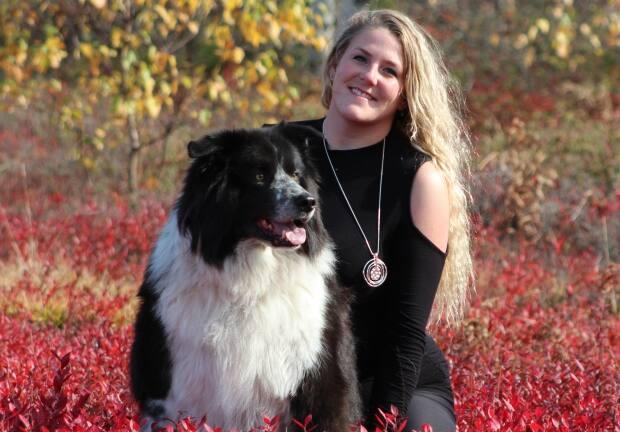 Hillary Hooper, seen here with her beloved dog, Blue, died by suicide at the Saint John Regional Hospital in December after numerous attempts to get help for depression.  (Submitted by Patty Borthwick - image credit)