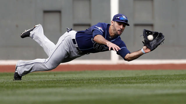 Tampa Bay Rays left fielder Sean Rodriguez dives to catch a line drive by Boston Red Sox's Jonny Gomes in the second inning in Game 1 of baseball's American League division series, Friday, Oct. 4, 2013, in Boston. (AP Photo/Michael Dwyer)