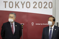 Tokyo Olympic and Paralympic Games Organising Committee (TOGOC) President Yoshiro Mori, left, and CEO Toshiro Muto speak to the media after their video conference with IOC President Thomas Bach, at the TOGOC headquarters in Tokyo Thursday, Jan. 28, 2021. The IOC and organizers in Japan repeatedly insisted on Wednesday there is no Plan B for the Tokyo Games, which were already postponed by one year during the coronavirus pandemic. (Takashi Aoyama/Pool Photo via AP)