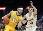 Valparaiso's John Kiser (33) heads to the basket past Loyola of Chicago's Clayton Custer during the second half of an NCAA college basketball game in the quarterfinal round of the Missouri Valley Conference tournament, Friday, March 8, 2019, in St. Louis. Loyola won 67-54. (AP Photo/Jeff Roberson)