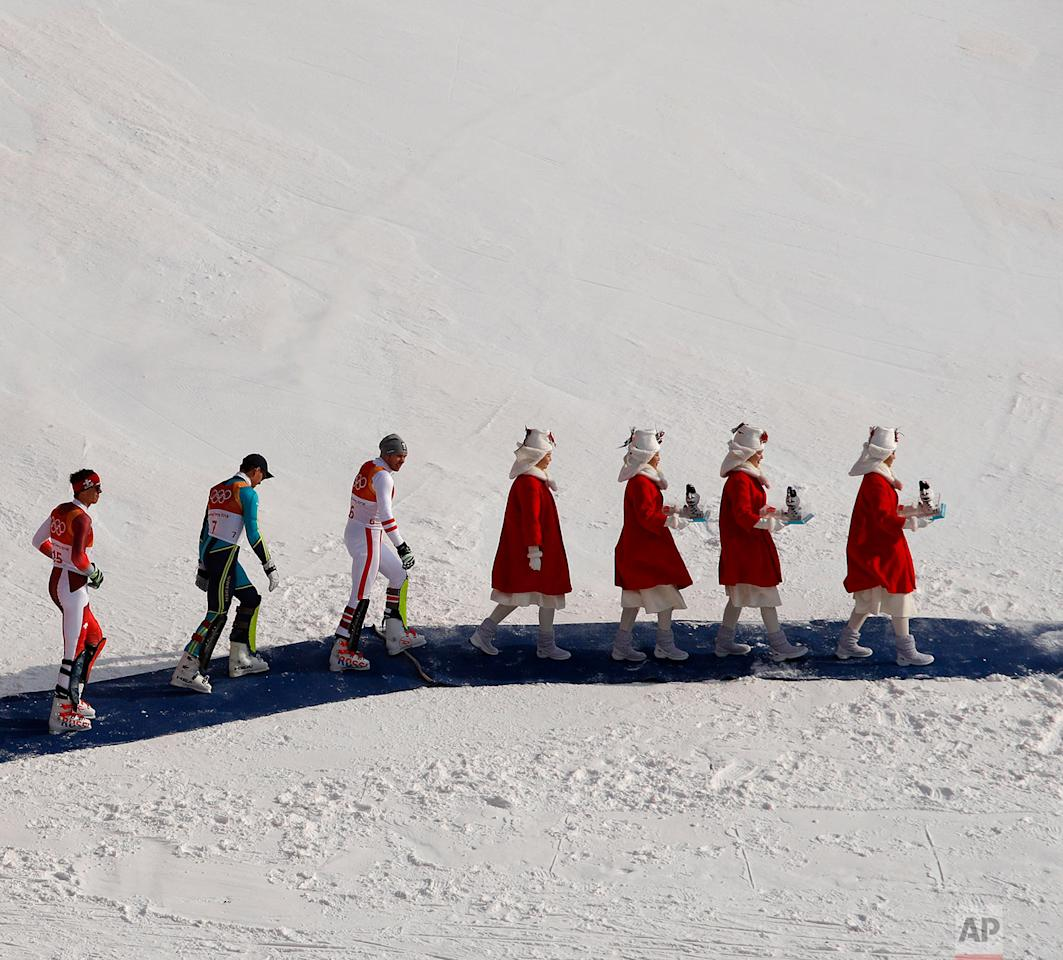 <p>Silver medalist Ramon Zenhaeusern, of Switzerland, left, gold medalist Andre Myhrer, of Sweden, and bronze medalist Michael Matt, of Austria, walk to the podium during the venue ceremony after the men's slalom at the 2018 Winter Olympics in Pyeongchang, South Korea. (AP Photo/Charlie Riedel) </p>