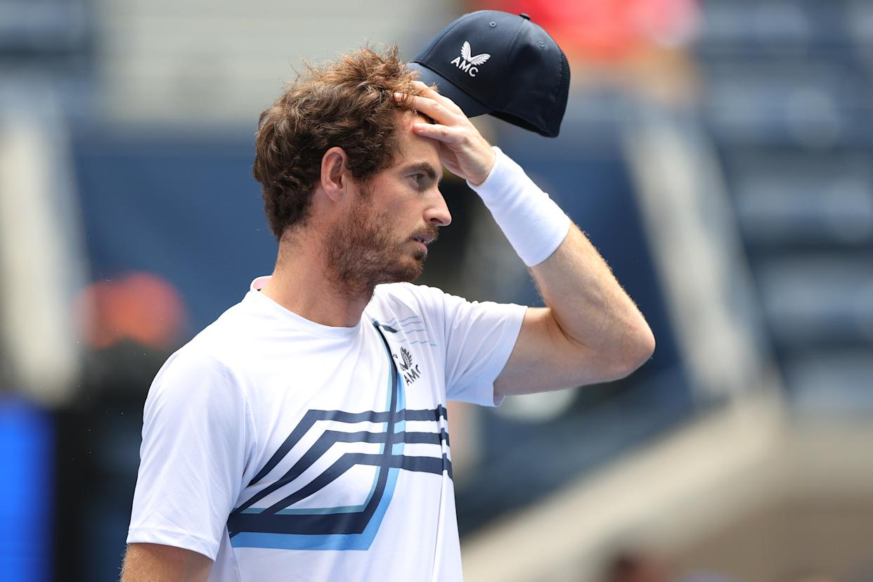 NEW YORK, NEW YORK - AUGUST 30: Andy Murray of United Kingdom reacts against Stefanos Tsitsipas of Greece during their men's singles first round match on Day One of the 2021 US Open at the Billie Jean King National Tennis Center on August 30, 2021 in the Flushing neighborhood of the Queens borough of New York City. (Photo by Elsa/Getty Images)