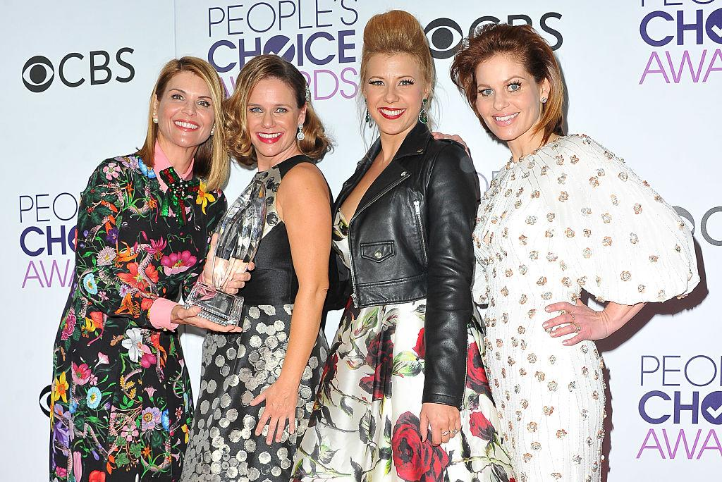 """Lori Loughlin and Andrea Barber pose with their """"Full House"""" co-stars Jodie Sweetin and Candace Cameron Bure at the 2017 People's Choice Awards at Microsoft Theater on Jan. 18, 2017, in Los Angeles. (Photo: Allen Berezovsky/Getty Images for Fashion Media)"""