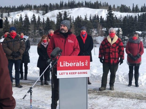 Premier Sandy Silver with Liberal MLAs in March, announcing the next territorial election. He'll have fewer Liberal MLAs to chose from now, when appointing his new cabinet.