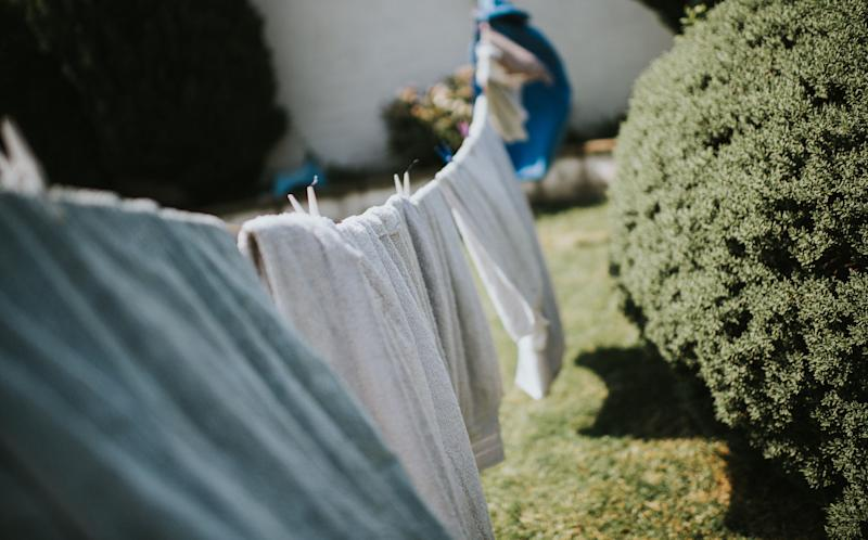 Clothes line in a garden (Photo: Catherine Falls Commercial via Getty Images)